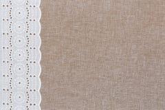 Textura de lino natural con el cordón blanco Imágenes de archivo libres de regalías