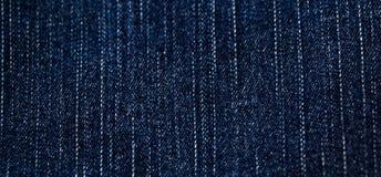 Textura de los pantalones vaqueros del dril de algodón. Fotografía de archivo libre de regalías
