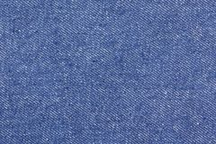 Textura de los tejanos inconsútiles, paño del detalle del dril de algodón para el modelo y fondo, cierre para arriba foto de archivo libre de regalías