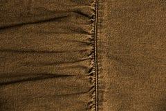 Textura de los vaqueros marrones Imagenes de archivo