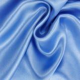 Textura de lujo azul elegante lisa del paño de la seda o del satén como abstra Foto de archivo