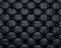 Textura de lujo de los muebles de cuero negros con los botones Foto de archivo libre de regalías