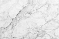 Textura de mármol blanca con las porciones de poner en contraste intrépido que vetean Fotografía de archivo