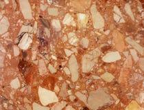 Textura de mármore O fundo é uma placa palyned Um produto feito da pedra Fragmentos de pedras pequenas Alise a superfície com um  fotos de stock