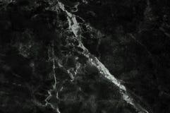 A textura de mármore preta disparou completamente com vear branco sutil Fotografia de Stock