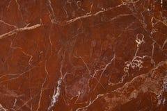 Textura de mármore vermelha do fundo Imagem de Stock Royalty Free