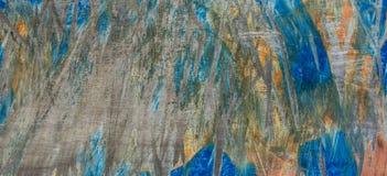 Textura de madeira com pintura azul e alaranjada rachada, fundo abstrato do vintage fotos de stock