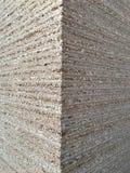 Textura de madeira da placa de partícula na vista lateral Fotografia de Stock Royalty Free