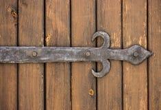 Textura de madeira escura com elementos forjados do metal Imagem de Stock Royalty Free