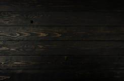 Textura de madeira escura preta do fundo Foto de Stock Royalty Free