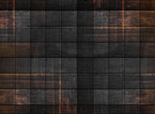 Textura de madeira escura velha com testes padrões quadrados foto de stock royalty free