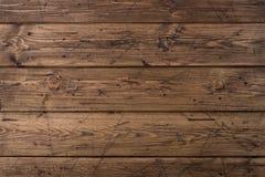 Textura de madeira marrom resistida velha das pranchas Fundo do Grunge Fundo de madeira marrom riscado da madeira Feche acima da  imagens de stock royalty free