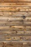 Textura de madeira riscada velha do vertical do painel de Brown Fotografia de Stock