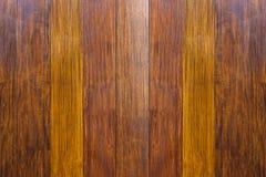 Textura de madeira A superfície da obscuridade o fundo de madeira natural marrom para o interior e o exterior da decoração do pro imagens de stock
