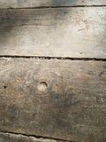 Textura de madeira velha da iluminação do lado do assoalho fotos de stock