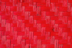 Textura de madeira vermelha do weave, fundo feito a mão da natureza Fotos de Stock