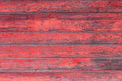 A textura de madeira vermelha velha com testes padrões naturais Foto de Stock