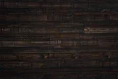 Textura de madera de marrón oscuro los paneles viejos del fondo Foto de archivo