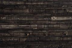 Textura de madera de marrón oscuro los paneles viejos del fondo Foto de archivo libre de regalías