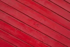Textura de madera pintada rojo de los tablones Foto de archivo