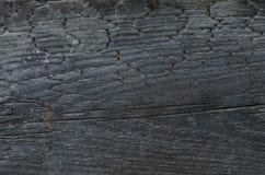 Textura de madera quemada del fondo de la pared Foto de archivo