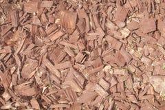 Textura de microplaquetas de madeira vermelhas Fotos de Stock Royalty Free