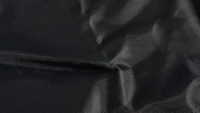 Textura de nylon negra del fondo de la tela, detallado grande texturizado almacen de metraje de vídeo