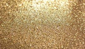 Textura de oro de la Navidad El color brillante, se enfoca en el centro Año Nuevo Foto de archivo