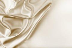 Textura de oro de la tela de seda Fotografía de archivo