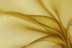 Textura de oro de la tela del organza Foto de archivo
