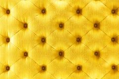 Textura de oro del paño del sofá del color Foto de archivo