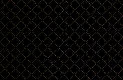 Textura de oro de la tela escocesa en fondo negro imágenes de archivo libres de regalías