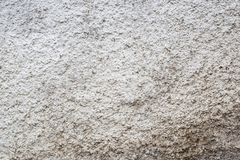 Textura de pedra cinzenta áspera suja branca do muro de cimento imagens de stock royalty free