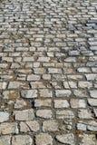 Textura de pedra do pavimento Fundo apedrejado godo do pavimento do granito foto de stock
