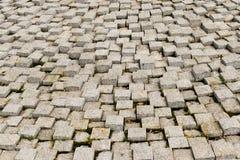 Textura de pedra do pavimento Fundo apedrejado godo do pavimento do granito Fundo abstrato do close-up velho do pavimento da pedr imagem de stock