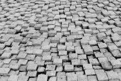Textura de pedra do pavimento Fundo apedrejado godo do pavimento do granito Fundo abstrato do close-up velho do pavimento da pedr fotografia de stock