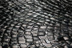 Textura de pedra do pavimento Fundo apedrejado godo do pavimento do granito Fundo abstrato do fim velho do pavimento da pedra Imagem de Stock Royalty Free