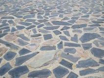 Textura de pedra escura do assoalho abstraia o fundo Imagens de Stock Royalty Free