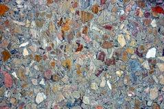 Textura de pedra marrom cinzenta de uma parte de mármore Foto de Stock