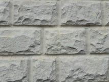Textura de pedra para decorar a fachada Forma retangular Fundo cinzento fotografia de stock royalty free