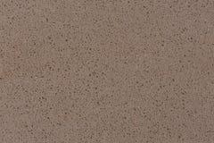 Textura de piedra beige artificial de la chispa del polvo para el fondo foto de archivo libre de regalías