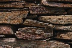 Textura de piedra de la pared de la pizarra, diseño de la arquitectura con las rocas Foto de archivo