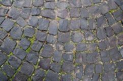 Textura de piedra del pavimento Fondo cobblestoned del granito Extracto del primer viejo del guijarro inconsútil praga fotos de archivo libres de regalías