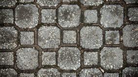 Textura de piedra del pavimento Fondo empedrado adoquín del pavimento del granito Fondo abstracto del primer viejo del pavimento  Fotos de archivo