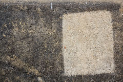 Textura de piedra gris del primer con el rastro de la casilla blanca Foto de archivo libre de regalías