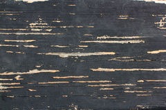 Textura de pranchas de madeira velhas com pintura preta rachada Fotos de Stock