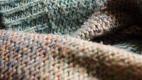 Textura de punto colorida de la tela Tiro detallado en 4k de un suéter hecho punto metrajes