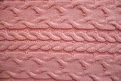Textura de punto de lanas rosadas fotos de archivo