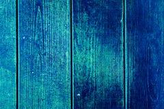Textura de tablones de madera viejos con la pintura agrietada y manchada Imagen de archivo libre de regalías