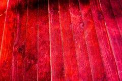 Textura de tablones de madera viejos con la pintura agrietada y manchada Foto de archivo